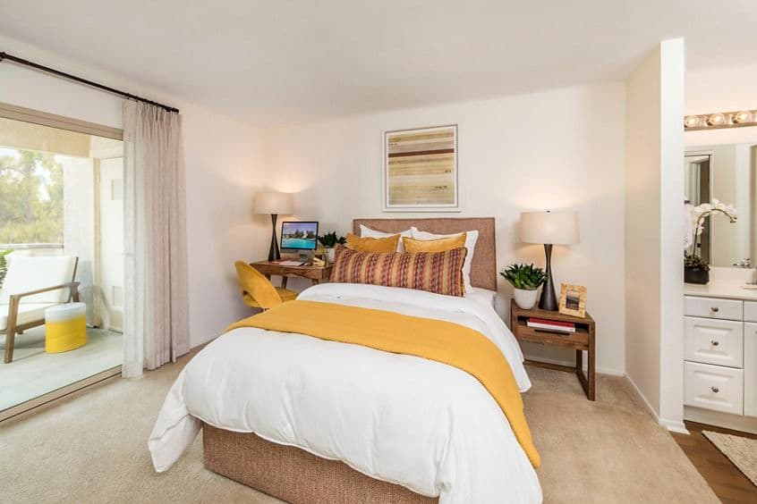 Interior view of bedroom at Stanford Court Apartment Homes at University Town Center in Irvine, CA.