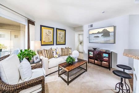 Interior view of living room at Stanford Court Apartment Homes at University Town Center in Irvine, CA.