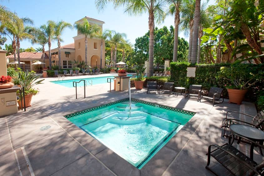 Exterior view of pool and spa at Villa Coronado Apartment Homes in Irvine, CA.