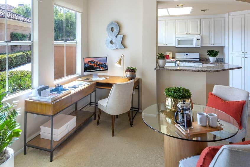 Interior view of dining room and desk at Villa Coronado Apartment Homes in Irvine, CA.