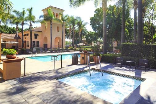 Pool view at Villa Coronado Apartment Homes in Irvine, CA.