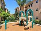 Exterior view of playground at Villa Coronado Apartment Homes in Irvine, CA.