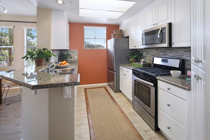 Interior view of kitchen at Villa Coronado Apartment Homes in Irvine, CA.