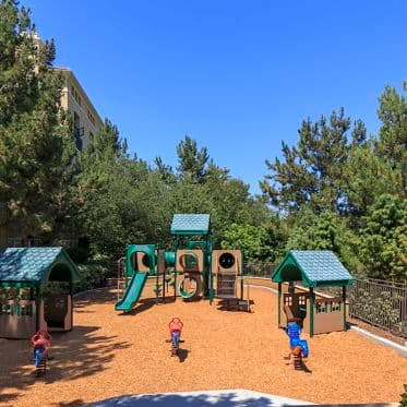 Exterior view of children's play area at Villa Siena Apartment Homes in Irvine, CA.