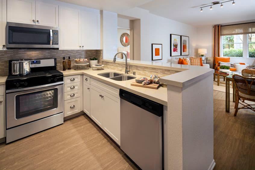 Interior view of kitchen at Villa Siena Apartment Homes in Irvine, CA.