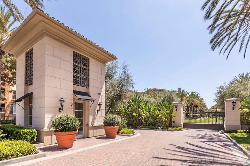 Exterior view of entry with guard gate at Villa Siena Apartment Homes in Irvine, CA.
