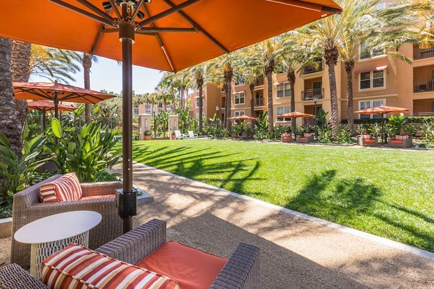 Exterior view of outdoor seating in courtyard at Villa Siena Apartment Homes in Irvine, CA.