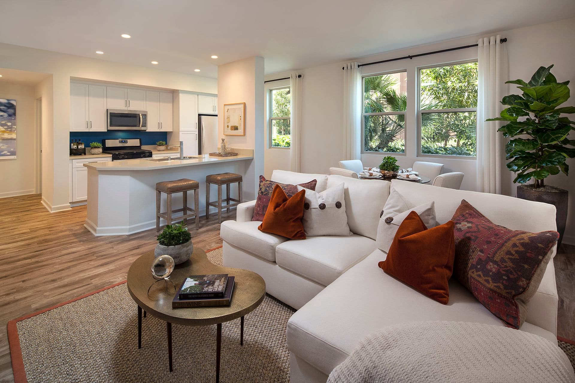 Living room and kitchen of Westview at Irvine Spectrum Apartment Homes in Irvine, CA.