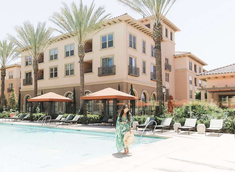 Talent Relaxing At Pool Westview Apartment Communities In Irvine