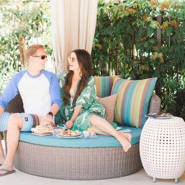 Couple lounging by pool at Westview Apartment Communities in Irvine.