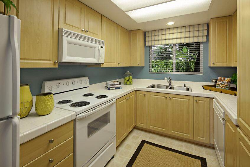 Interior view of kitchen at Windwood Glen Apartment Homes in Irvine, CA.
