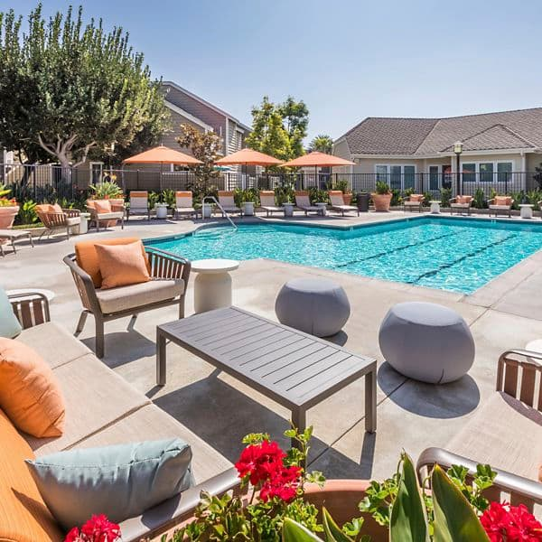 Exterior view of pool area at Windwood Glen Apartment Homes in Irvine, CA.