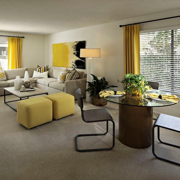 Interior view of living room and dining room at Windwood Knoll Apartment Homes in Irvine, CA.
