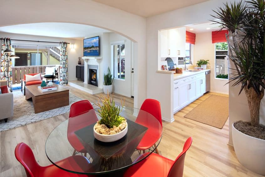 Interior view of dining room and living room at Woodbridge Pines Apartment Homes in Irvine, CA.