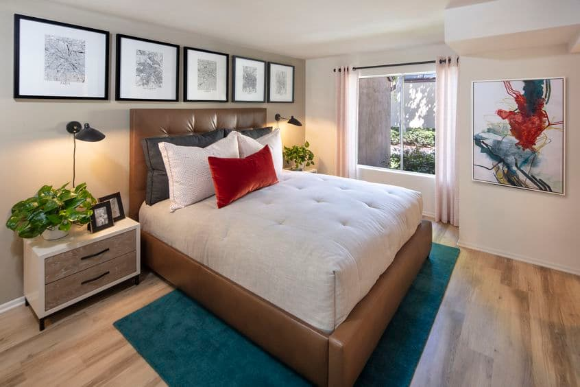 Interior view of bedroom at  Woodbridge Pines Apartment Homes in Irvine, CA.