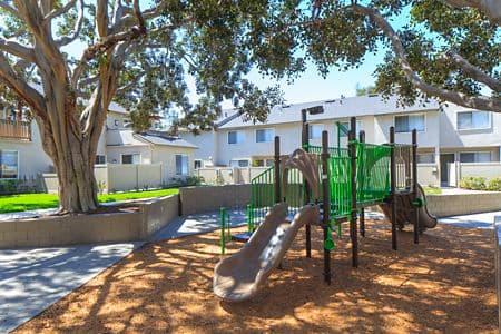 Exterior view of playground at Woodbridge Villas Apartment Homes in Irvine, CA.
