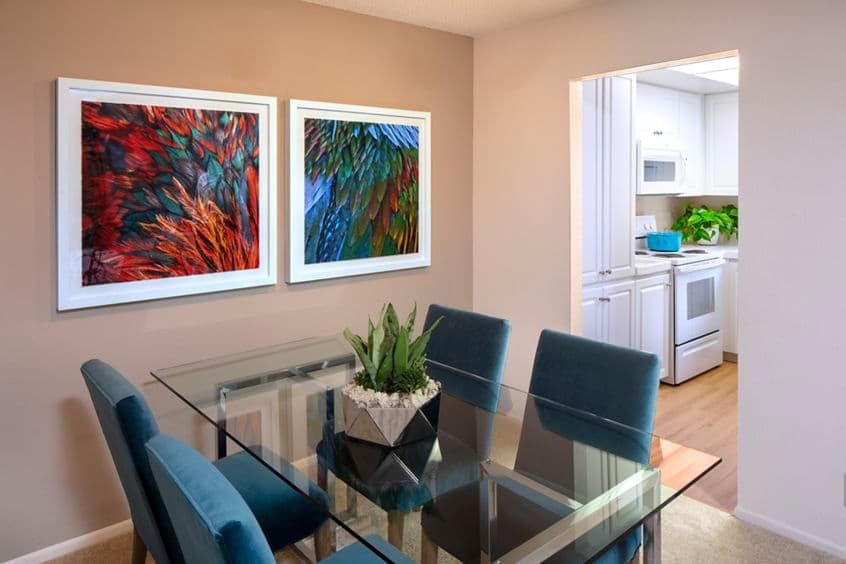 Interior view of dining room and kitchen at Woodbridge Willows Apartment Homes in Irvine, CA.