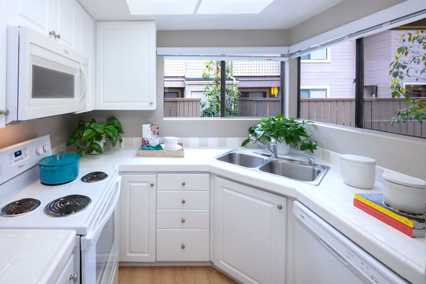 Interior view of kitchen at Woodbridge Willows Apartment Homes in Irvine, CA.