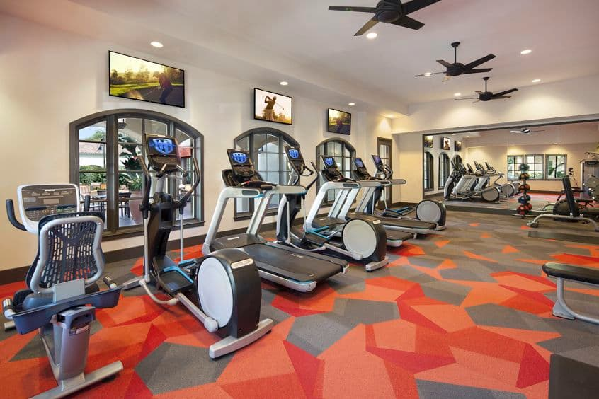 Interior view of the fitness center at Woodbury Court Apartment Homes in Irvine, CA.