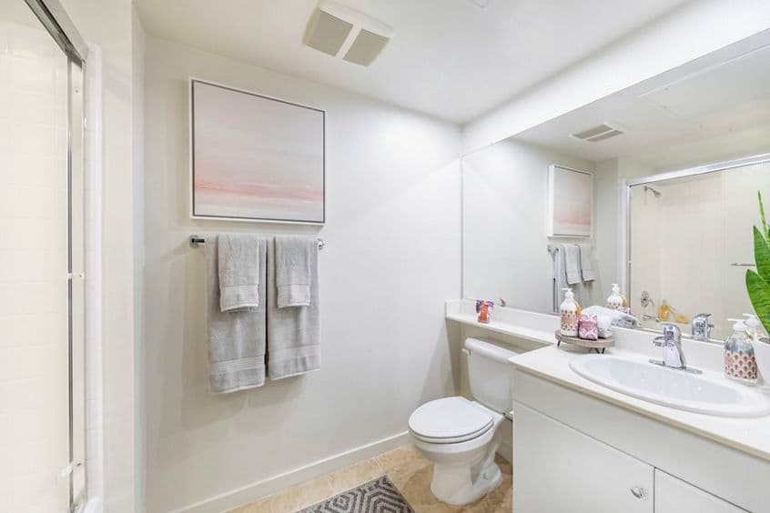 Interior view of bathroom at Woodbury Court Apartment Homes in Irvine, CA.