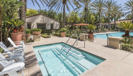 Exterior view of pool at Woodbury Lane Apartment Homes in Irvine, CA.