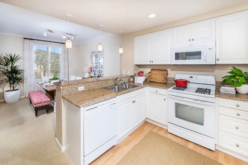 Interior view of Kitchen at Woodbury Lane Apartment Homes in Irvine, CA.
