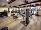 Interior view of fitness center at Woodbury Place Apartment Homes in Irvine, CA.