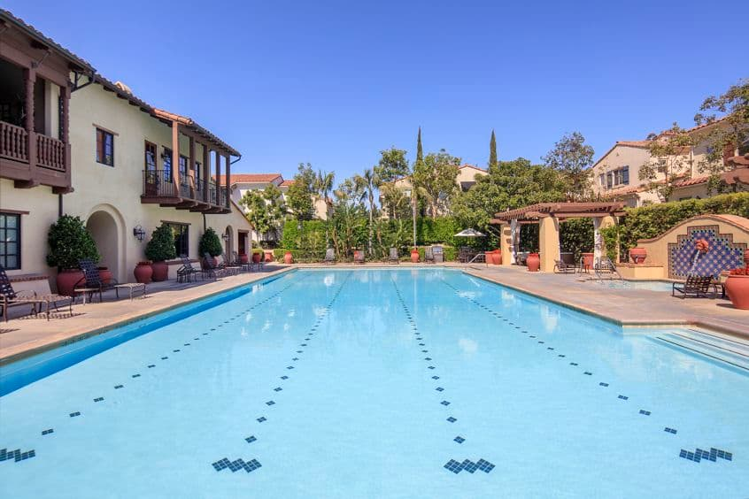 Exterior view of pool at Woodbury Place Apartment Homes in Irvine, CA.