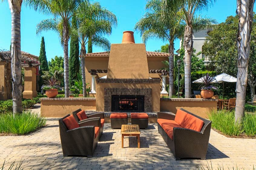 Exterior view of fireplace at Woodbury Square Apartment Homes in Irvine, CA.