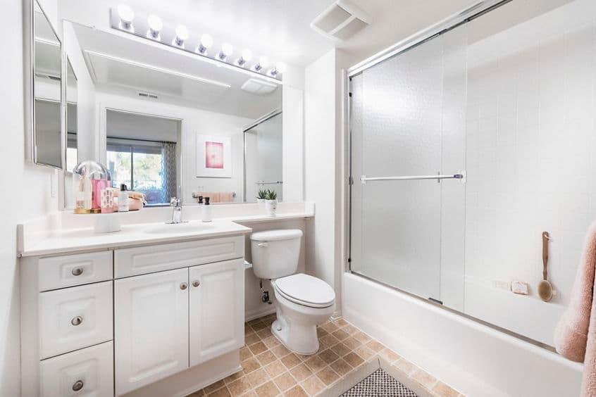 Interior view of bathroom at Woodbury Square Apartment Homes in Irvine, CA.