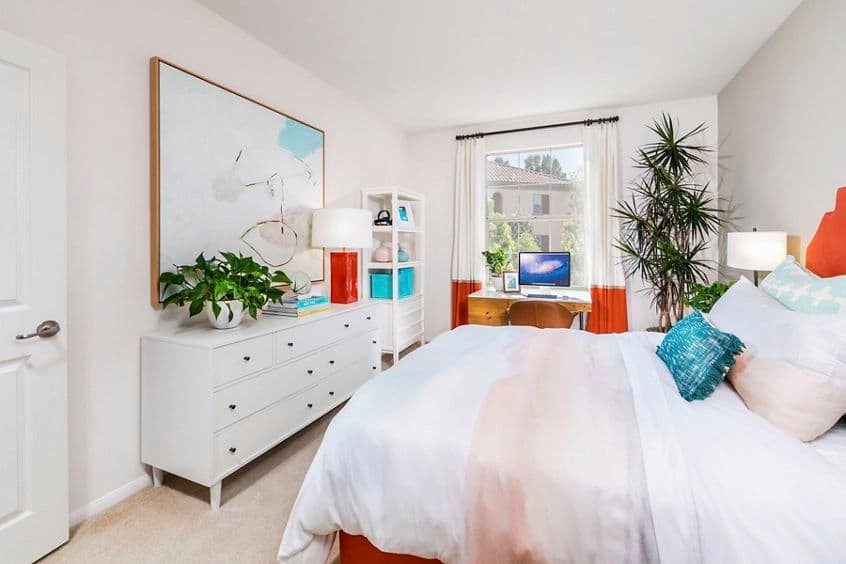 Interior view of bedroom at Woodbury Square Apartment Homes in Irvine, CA.