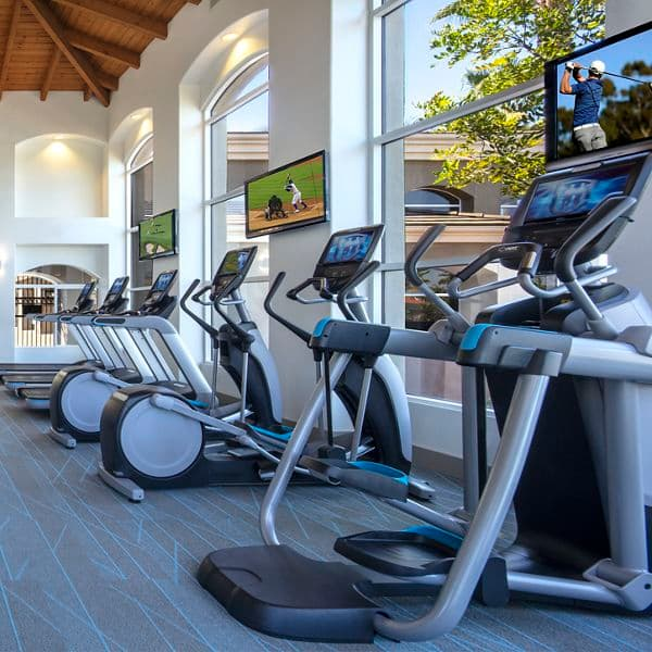 Interior view of fitness center at Vista Real Apartment Homes in Mission Viejo, CA.