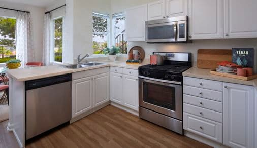 Interior view of kitchen at Vista Real Apartment Homes in Mission Viejo, CA.