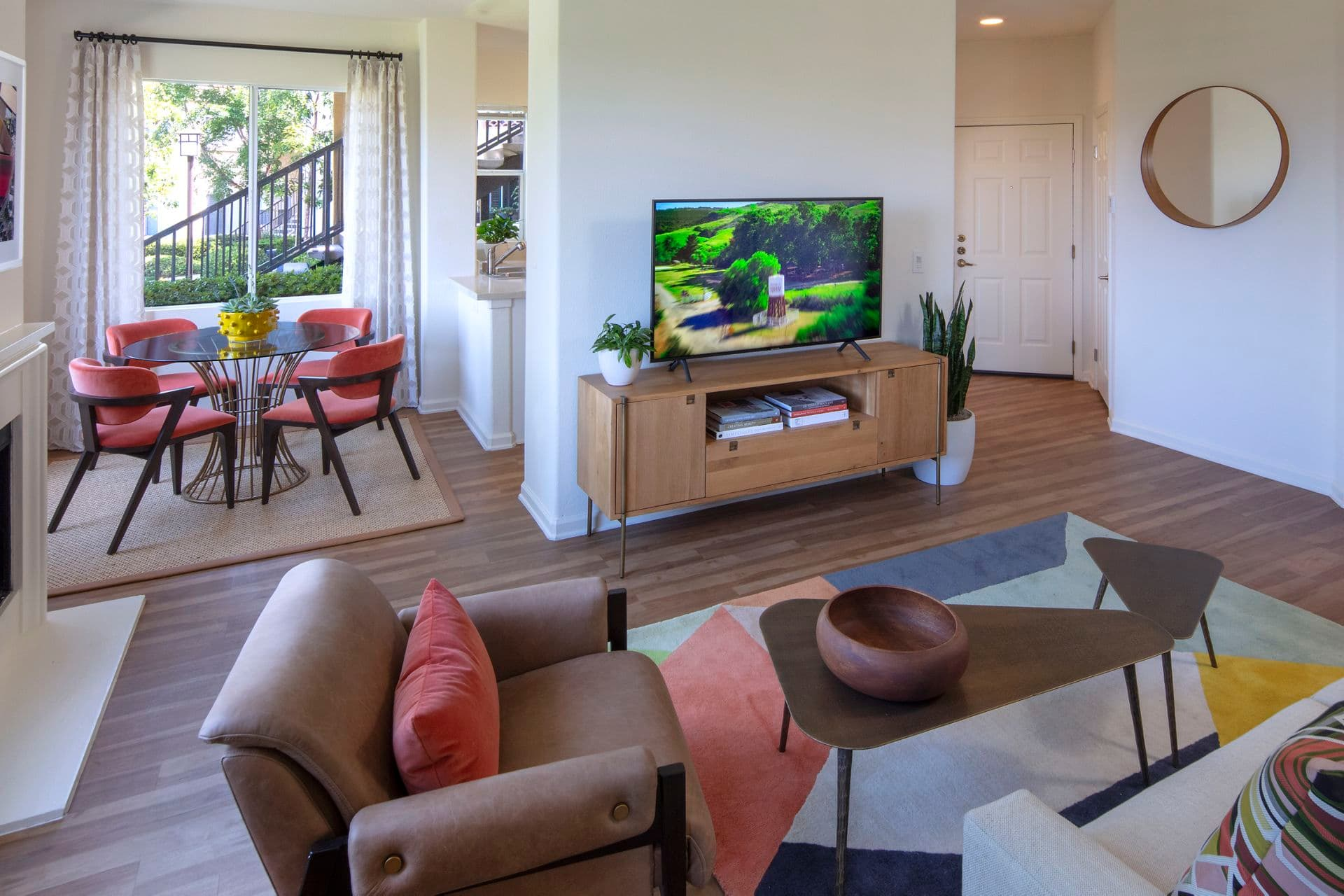 Interior view of living room and dining room at Vista Real Apartment Homes in Mission Viejo, CA.