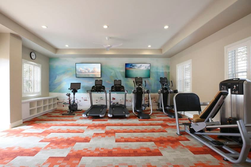 Interior view of fitness center at Baypointe Apartment Homes in Newport Beach, CA.