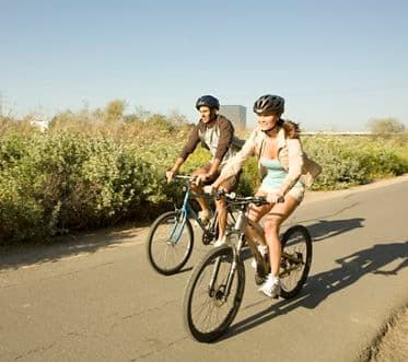 Baypoint Apartment Homes Photo Shoot: Couple riding bikes on pathway. Mitchell 2008.
