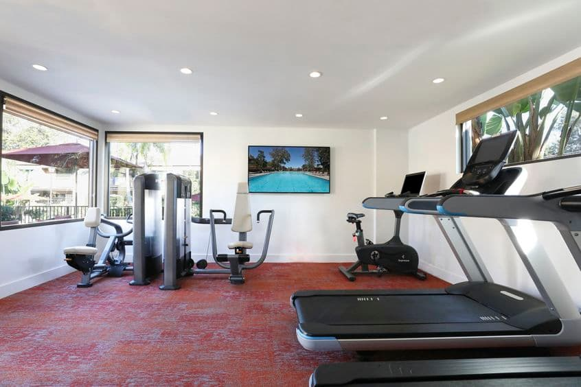 Interior view of fitness center at Baywood Apartment Homes in Newport Beach, CA.