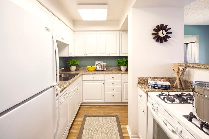 Interior view of kitchen at The Bays  Apartment Homes in Newport Beach, CA.