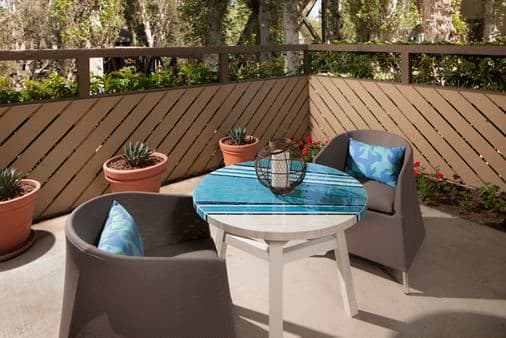 Exterior view of patio at The Bays Apartment Homes in Newport Beach, CA.
