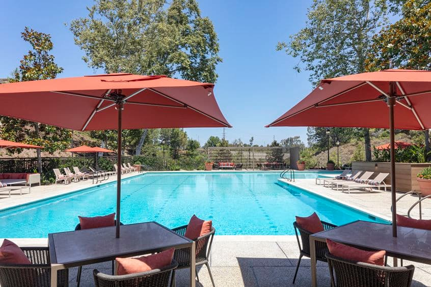 Exterior pool view at Baywood Apartment Homes in Newport Beach, CA.