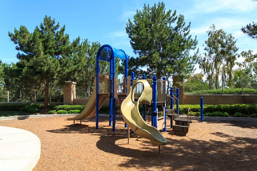 Exterior view of playground at Bordeaux Apartment Homes in Newport Beach, CA.
