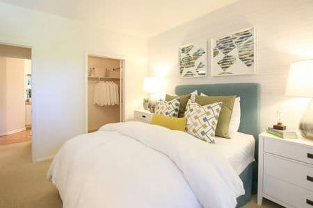 Interior view of bedroom at Newport Bluffs Apartment Homes in Newport Beach, CA.