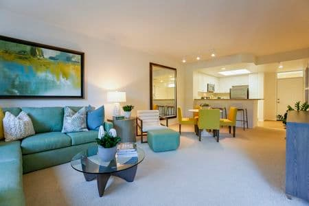 Interior view of living room and dining room at Newport Bluffs Apartment Homes in Newport Beach, CA.