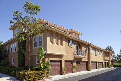 View of building exterior and garages at Newport Bluffs Apartment Homes in Newport Beach, CA.
