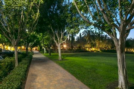 Evening view of the park at Newport Bluffs Apartment Homes in Newport Beach, CA.