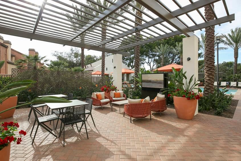 Exterior view of outdoor patio at Newport North Apartment Homes in Newport Beach, CA.