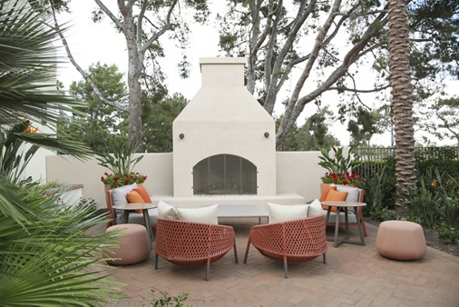 Exterior view of outdoor courtyard at Newport North Apartment Homes in Newport Beach, CA.
