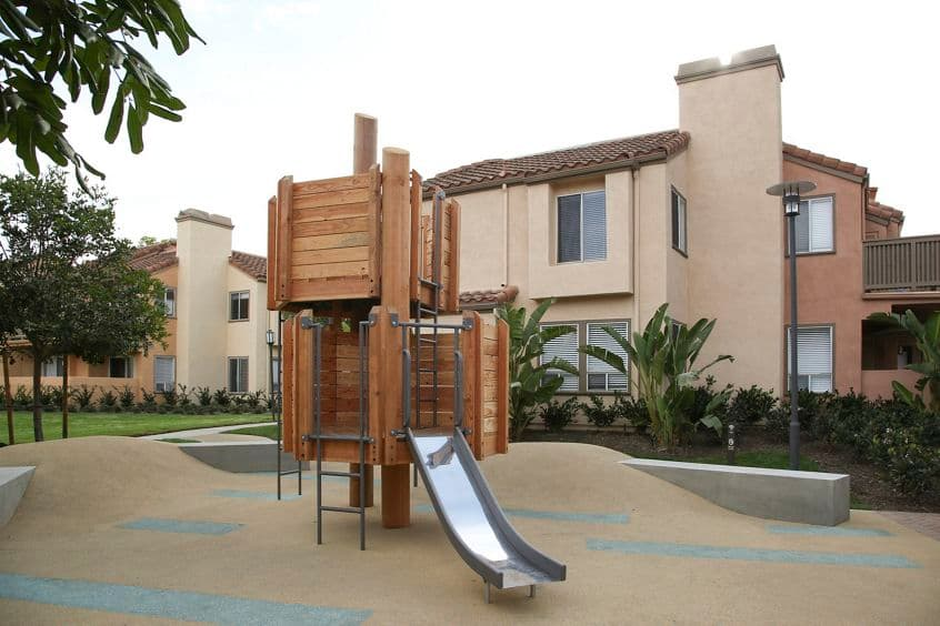 Exterior view of playground at Newport North Apartment Homes in Newport Beach, CA.