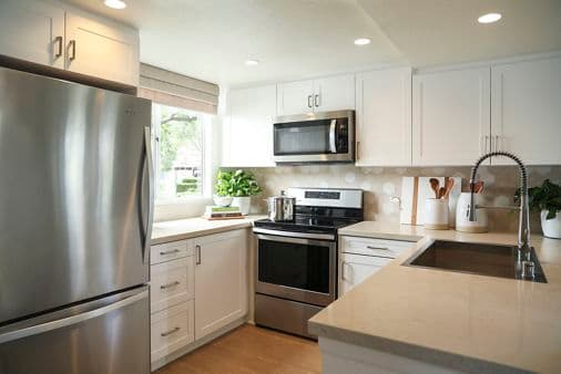 Interior view of kitchen at Newport North Apartment Homes in Newport Beach, CA.