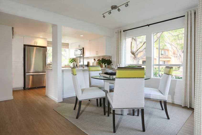 Interior view of kitchen and dining room at Newport North Apartment Homes in Newport Beach, CA.